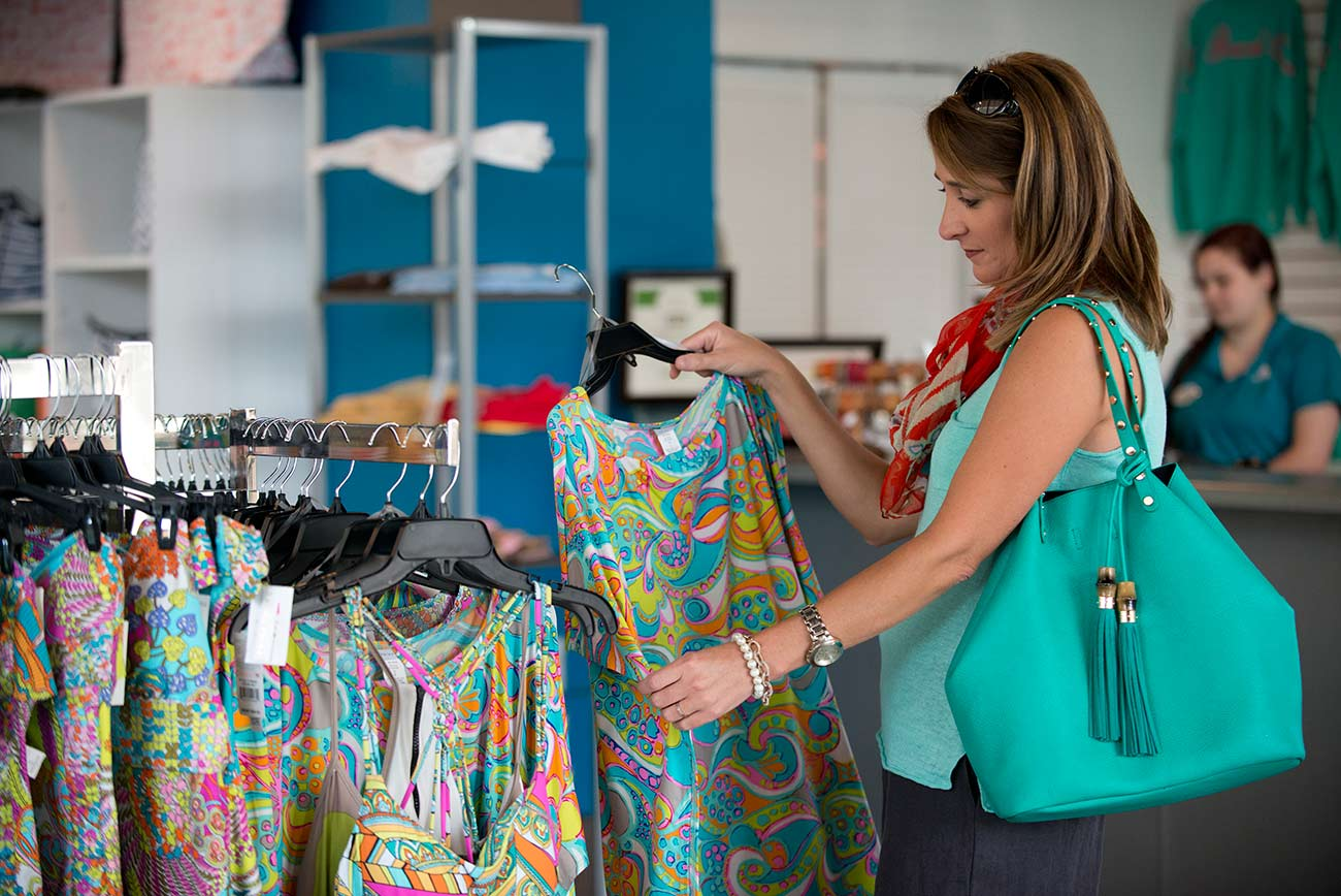 woman shopping at the village mercantile at the beach club resort