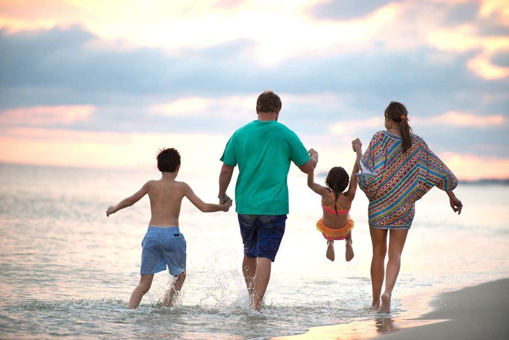 Family enjoying the Gulf Coast at The Beach Club Resort Gulf Shores Alabama