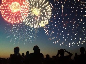 a crowd watching fireworks