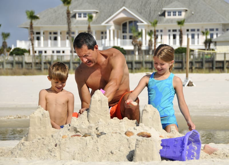 Family building sandcastle