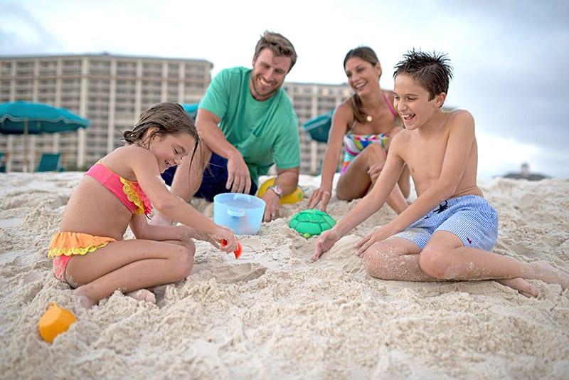 Family plays on Alabama's Beaches