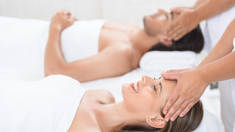 Couple enjoys massage at The Spa at The Beach Club
